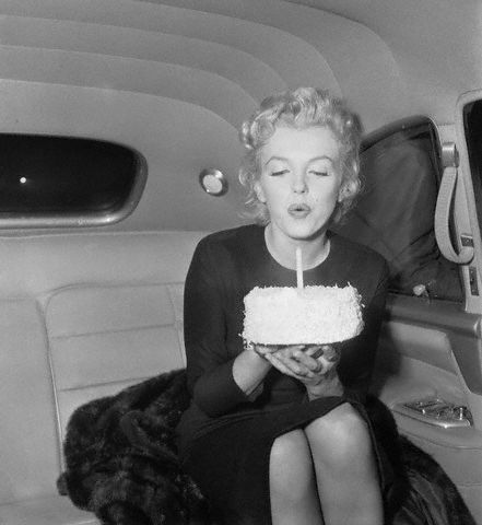Marilyn Monroe Blowing Out Candle on 30th Birthday Cake